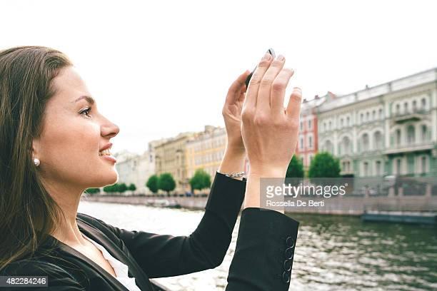 Cheerful Woman Taking A Selfie In Saint Petersburg, Russia