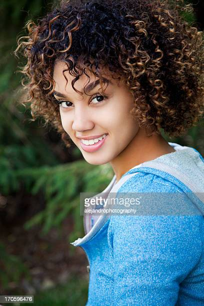 Cheerful woman with curly hair