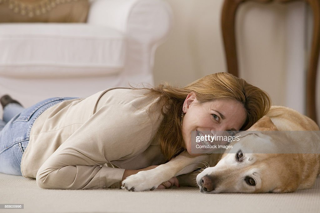 Cheerful woman with dog : Stock Photo