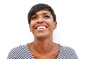 Close up portrait of a cheerful young african american woman smiling against white background