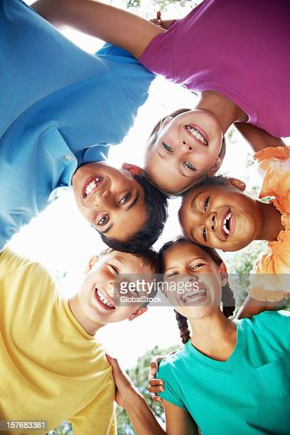 Cheerful young children enjoying their vacation against sky