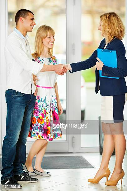 Cheerful Young Couple Buying Car.
