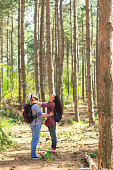 Cheerful young couple enjoying the forest hiking