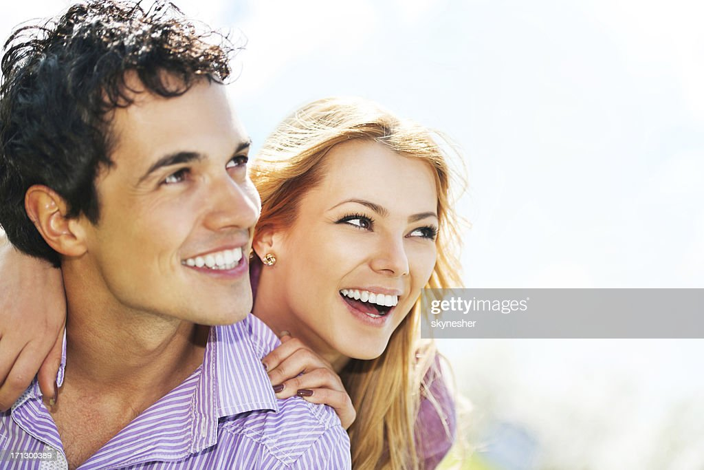 Cheerful young couple in love. : Stock Photo