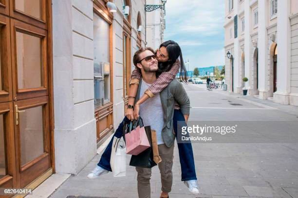 cheerful young couple in shopping