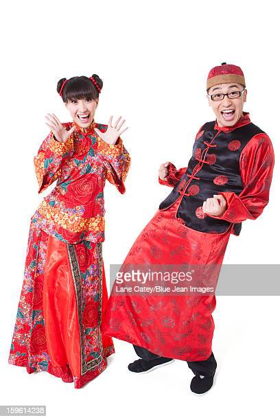 Cheerful young couple in traditional Chinese clothing