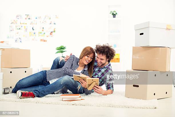 Cheerful young couple moving to new apartment.