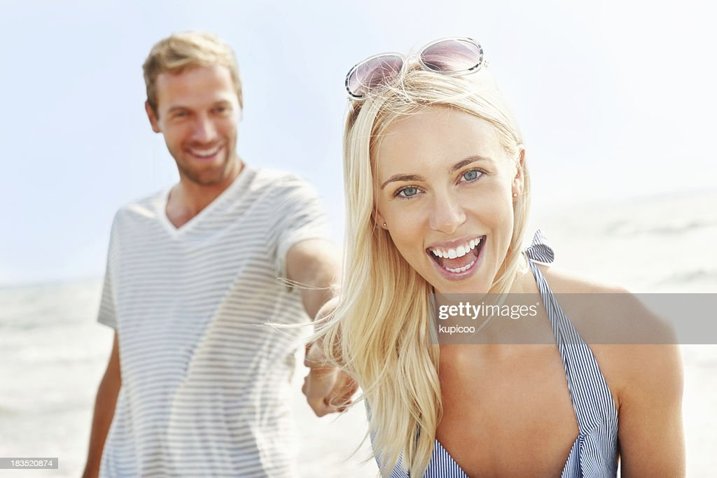 Cheerful young girl with boyfriend together having fun : Stock Photo