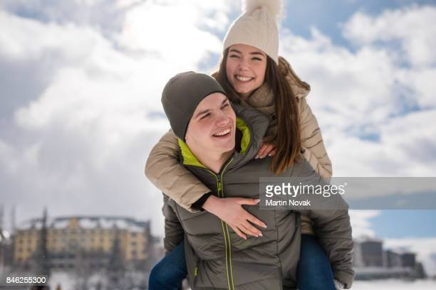 Cheerful young love couple enjoying every moment together