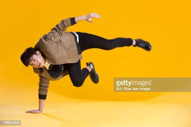 Cheerful young man dancing