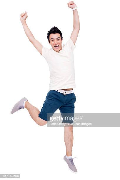 Cheerful young man jumping