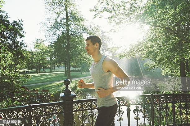 Cheerful Young Man Running Outdoors In The Early Morning
