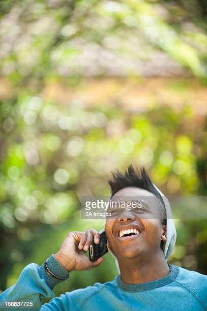 Cheerful young man talking on mobile phone, Johannesburg, South Africa