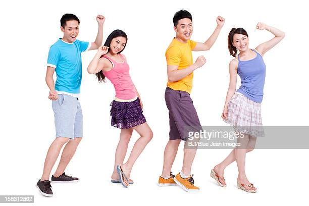 Cheerful young people dancing