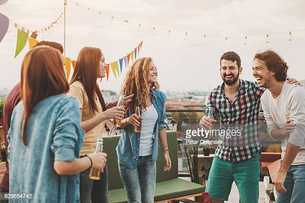 Cheerful young people drinking beer