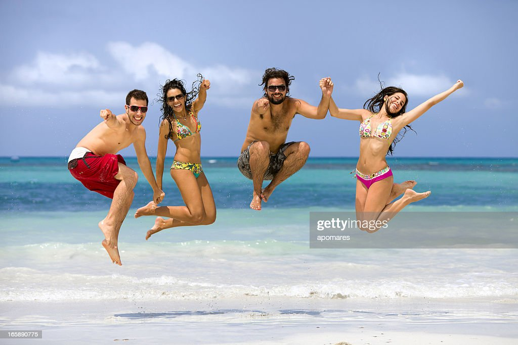 Cheerful young people having fun on a tropical turquoise beach