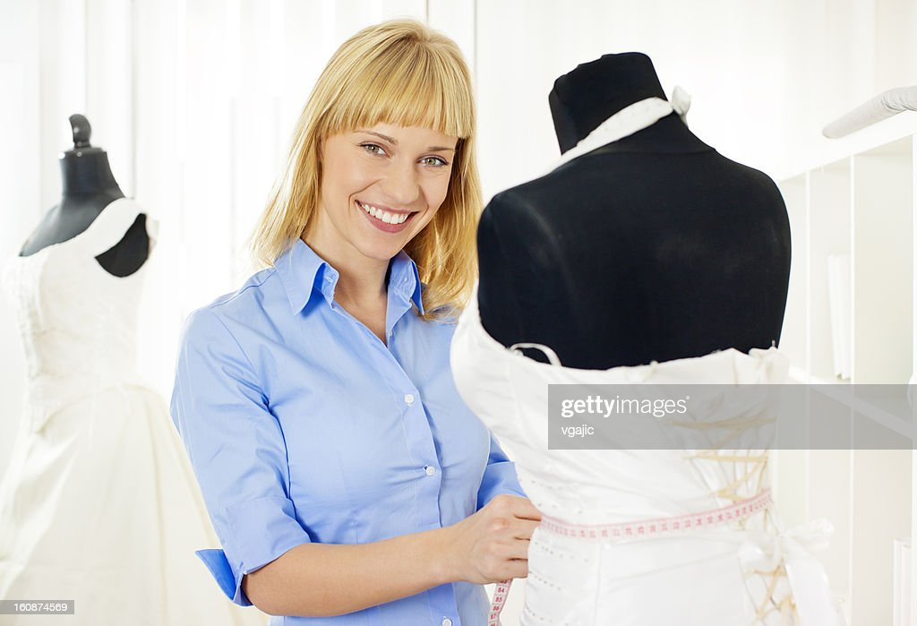 Cheerful Young Woman Dressmaker. : Stock Photo