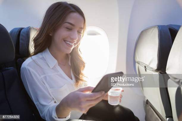 Cheerful young woman relaxes during air travel