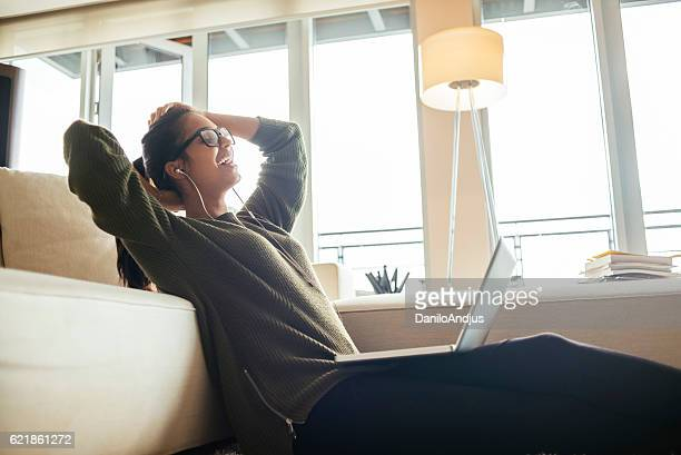 cheerful young woman relaxing after using her laptop