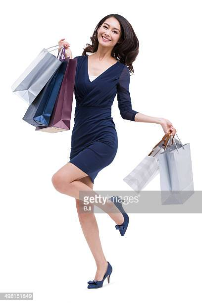 Cheerful young woman shopping