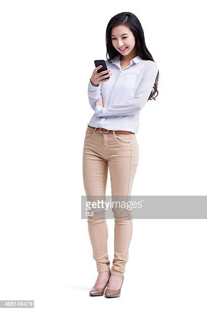 Cheerful young woman text messaging