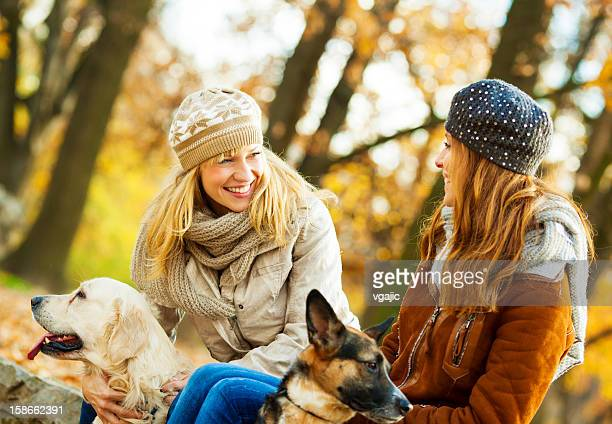 Cheerful Young Woman With Dogs outdoors.