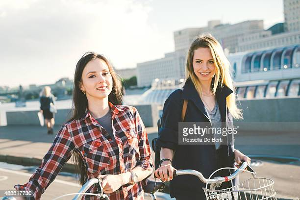 Cheerful Young Women Cycling In The Park