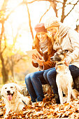 Cheerful Young Women With Dogs outdoors.