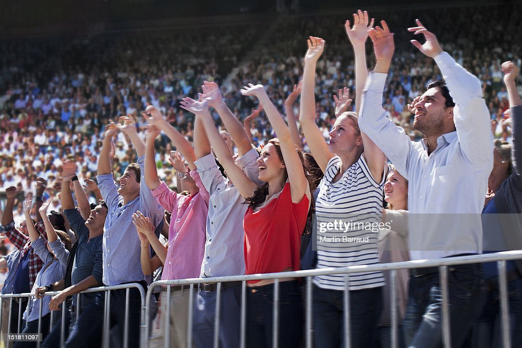Cheering crowd in stadium : Stock Photo