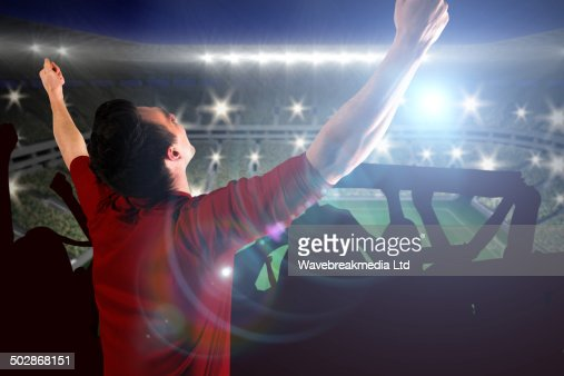 Composite image of cheering football fan in red jersey : Stock-Foto