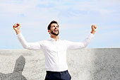 Businessman cheering in white shirt