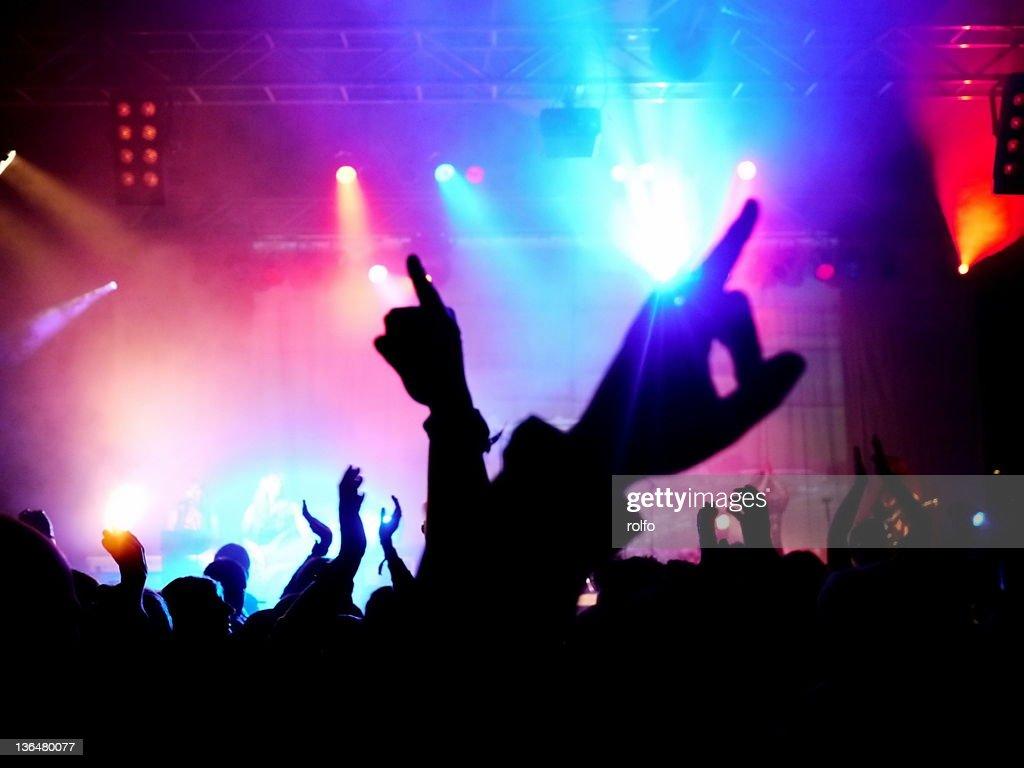 Cheering in concert : Stock Photo