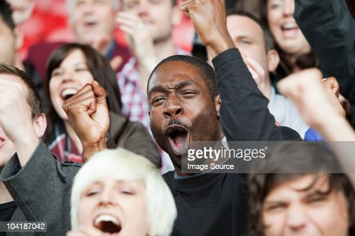 Cheering man at football match : Stock Photo