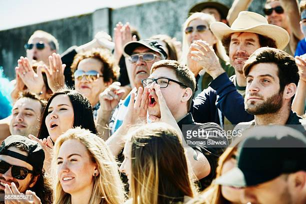 Cheering man in stadium during soccer match