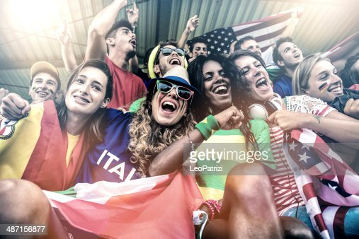 Cheering multi-ethnic game supporters