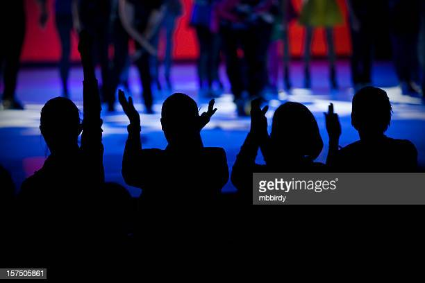 Cheering silhouettes on dance show
