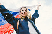Cheering woman under Russian flag.