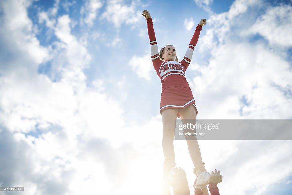 Cheerleadear on top of the success : Stock Photo
