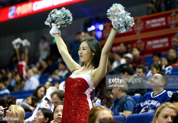 A cheerleader entertains fans during the preseason game between the the Los Angeles Kings and the Vancouver Canucks at the MercedesBenz Arena...