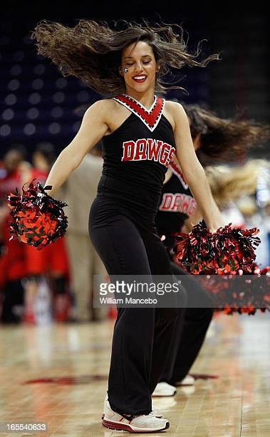 A cheerleader for the Georgia Lady Bulldogs performs at the game against the Stanford Cardinal during the NCAA Division I Women's Basketball Regional...
