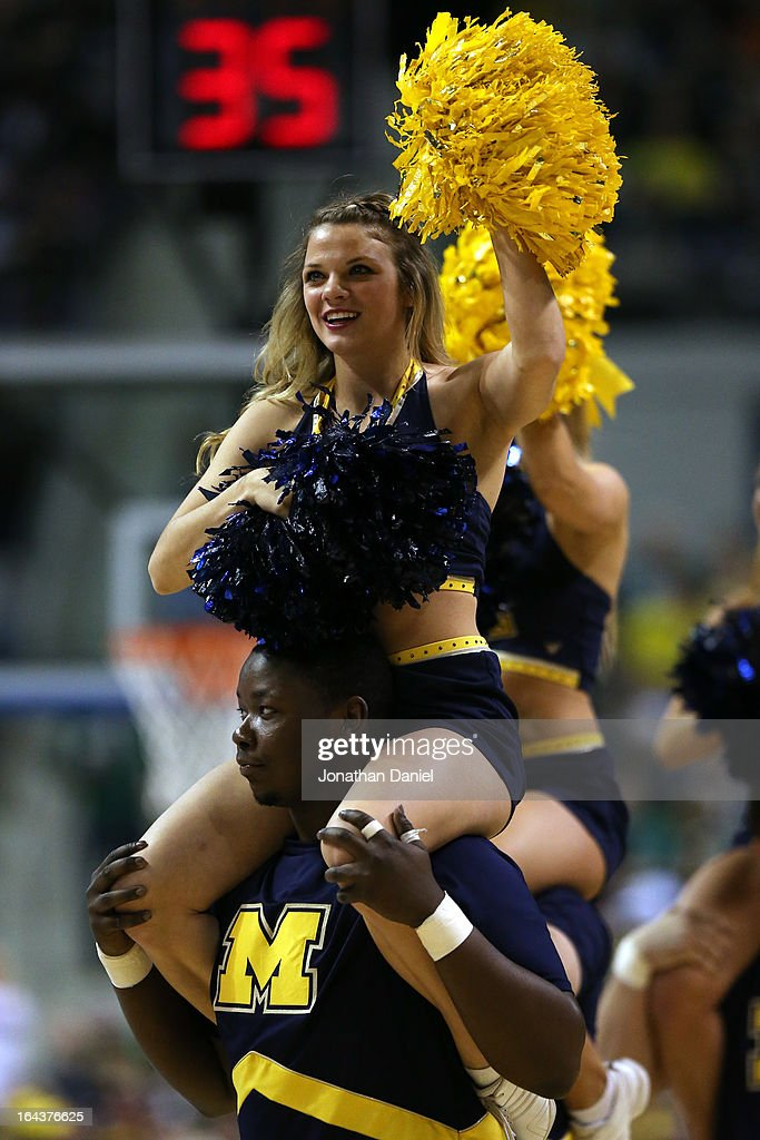 A cheerleader for the Michigan Wolverines performs against the Virginia Commonwealth Rams during the third round of the 2013 NCAA Men's Basketball Tournament at The Palace of Auburn Hills on March 23, 2013 in Auburn Hills, Michigan.