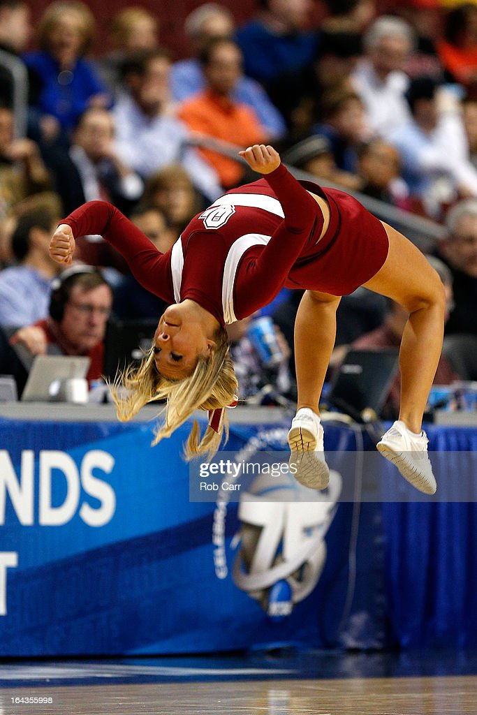 A cheerleader for the Oklahoma Sooners performs against the San Diego State Aztecs during the second round of the 2013 NCAA Men's Basketball Tournament at Wells Fargo Center on March 22, 2013 in Philadelphia, Pennsylvania.