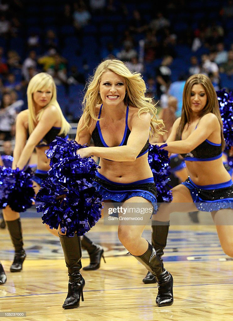 A cheerleader for the Orlando Magic performs during the game against the New Orleans Hornets at Amway Arena on October 10, 2010 in Orlando, Florida.