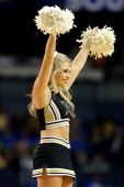 A cheerleader for the Vanderbilt Commodores performs during the second round of the SEC Men's Basketball Tournament at Bridgestone Arena on March 14...