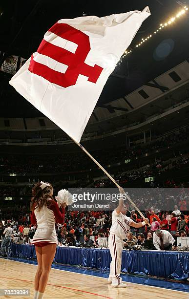A cheerleader from the Indiana Hoosiers waves a flag on the court during warmups against the Illinois Fighting Illini during the quarterfinals of the...