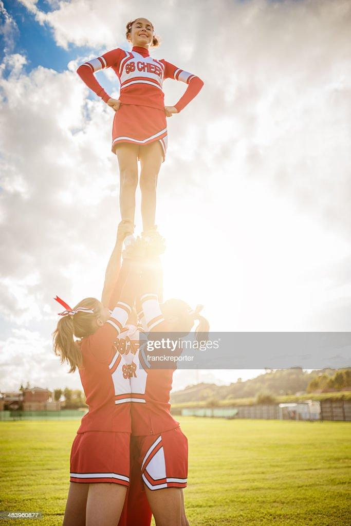 Cheerleader girl on top of the success : Stock Photo