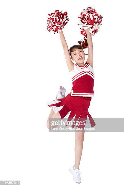 Cheerleader in action with her pom-poms