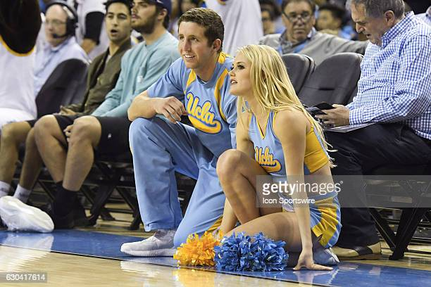 UCLA cheerleader looks on during an NCAA basketball game between the UC Santa Barbara Gauchos and the UCLA Bruins on December 14 at Pauley Pavilion...