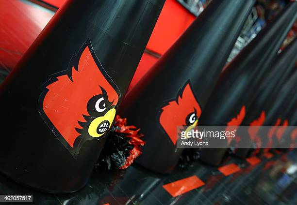 Cheerleader megaphones of Louisville Cardinals sit on the court during the game against the SMU Mustangs at KFC YUM Center on January 12 2014 in...
