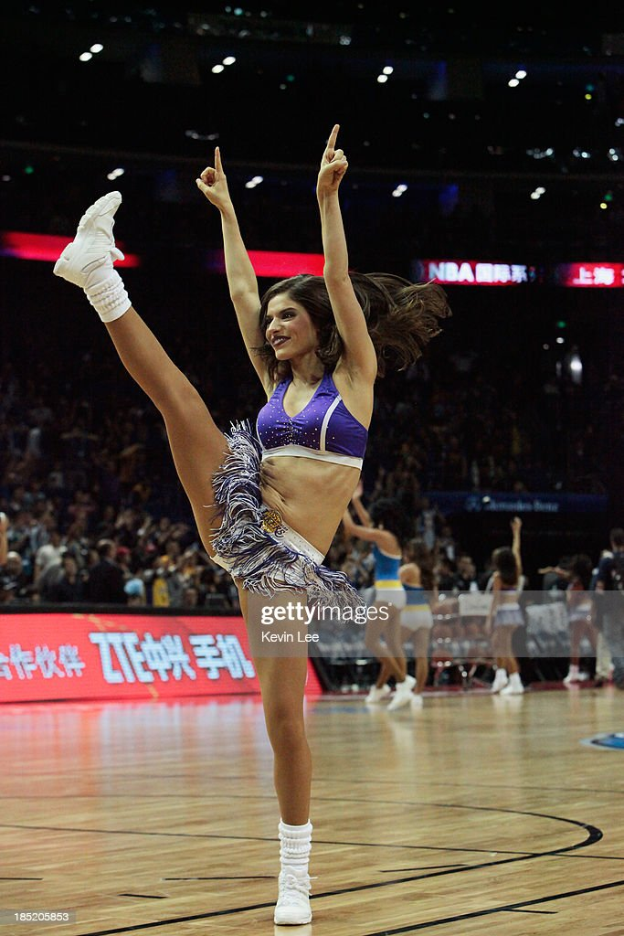 A cheerleader of Golden State Warriors performs during the NBA match between the Los Angeles Lakers and the Golden State Warriors on October 18, 2013 in Shanghai, China.